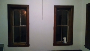 The window on the right is original, and clean (well the inside). The windoow on the left is dirty and mostly plexiglass.